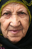 Old lady portrait. An old poor muslim turkish lady  portrait Stock Image