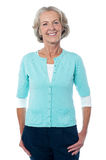 Old lady posing casually, full length portrait. Stock Photography