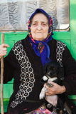 The old lady with a puppy. Royalty Free Stock Photography