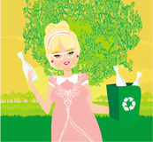 Old lady recycling plastic bottles Royalty Free Stock Image