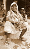 Old India lady relaxing with family. An Old Indian lady in Indian village sparing some time to relax after a day long hard work Royalty Free Stock Images