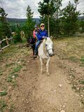 Old Lady Riding A Horse With Grandkids In Colorado Royalty Free Stock Image