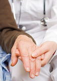 Old lady's hand. Young doctor holds old lady's hand Stock Image