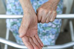 Old lady`s hand. Elderly lady is waiting for help. Senior lady experiencing bad service and conditions in retirement stock images
