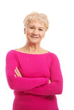 An old lady's portrait in pink casual clothes. Royalty Free Stock Images