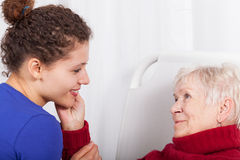 The old lady is satisfied with the care. Nurses Royalty Free Stock Image