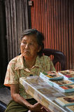 An old lady selling souvenir at Chew Jetty, Penang Royalty Free Stock Images