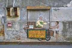 Old lady selling Susu Soya Asli & Segar Street Art Mural in Georgetown, Penang, Malaysia. Old lady selling Susu Soya Asli & Segar Street Art Mural in George Town Stock Images