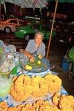 Old lady sells flowers at Pak Khlong Thalat Royalty Free Stock Image