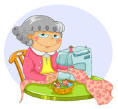Old lady sewing. Happy old lady sewing with a machine Royalty Free Stock Photos