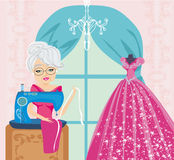 Old lady with sewing machine Royalty Free Stock Image