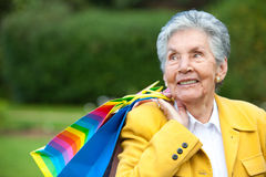 Old lady shopping Stock Photography