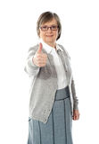 Old lady showing thumbs up gesture. Isolated against white background Stock Photography
