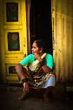 An old lady sits on a step in the Dharavi Slums in Mumbai India Royalty Free Stock Images