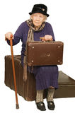 The old lady sits on a suitcase Stock Photography