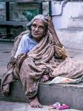 Old lady sitting in Madurai street, Tamil Nadu, India. Royalty Free Stock Photos