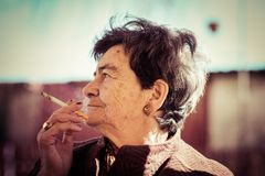 Old lady smoking a cigar Royalty Free Stock Image