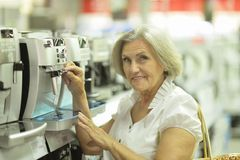 Old lady in store Royalty Free Stock Image