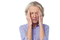 Old lady suffering from headache Stock Photo