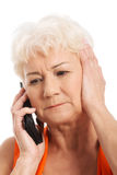An old lady talking through phone. Stock Photo