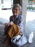 Old lady, Thailand. BANGKOK, THAILAND - SEPTEMBER 23 : Old lady begs for money on the side of the road in central Bangkok. September 23, 2007 in Bangkok Royalty Free Stock Images
