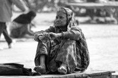 A lady thinking on ghaat. stock images