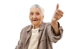 Old lady with thumbs up. Old lady showing thumbs up in front of an isolated background Royalty Free Stock Image