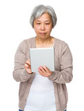 Old lady use of tablet Stock Photography