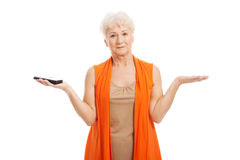 An old lady using mobile phone. Stock Photography