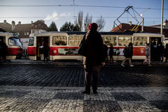 Old lady waiting for tram. Tram transportation offers a good tour throughout the city and often is recommended for sightseeing. An old lady sees people passing Royalty Free Stock Image