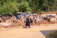 Old lady walking on the dirt road Royalty Free Stock Image