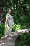 Old lady walking in garden Royalty Free Stock Photography