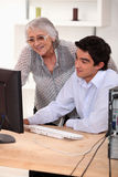 Old lady and young man= Stock Images