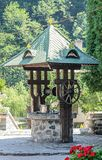 The old Lainici Monastery on a summer`s day, detail from the courtyard with exterior fountain. Stock Photo