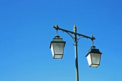 Old Lamp. On blue sky Royalty Free Stock Images