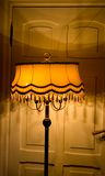 Old lamp. Vintage beautiful lamp against retro door in Jaunmoku castle Stock Image