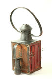 Old lamp. Old rusty railroad lamp with a red glass with Clipping path Royalty Free Stock Image
