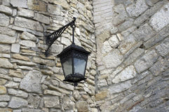 Old lamp. On a fortress wall Stock Photo
