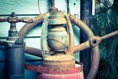 Old lamp. Hurricane lamp/storm lantern; very corroded vintage kerosene lamp Royalty Free Stock Image