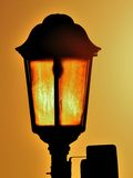 Old Lamp Back Lit By Sun. A detail from North Pier, Blackpool, England Royalty Free Stock Photos