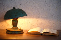 Old lamp and book stock images