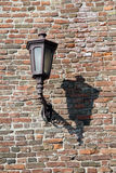 Old lamp on the brick wall Stock Photo
