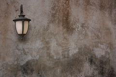 Old lamp and cement wall. Royalty Free Stock Photography