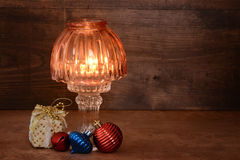 Old lamp with christmas ornaments. On old wood Royalty Free Stock Images