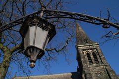 Old lamp and church. Stock Photo