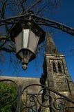 Old lamp and church. Stock Photos