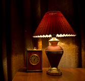 Old lamp and clock Royalty Free Stock Photo