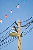 Old lamp on the electric pole Royalty Free Stock Photography