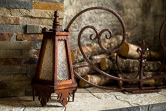 Old lamp. By the fireplace stock photography
