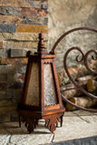 Old lamp. By the fireplace stock photos